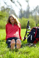 Girl cyclist barefoot enjoying relaxation