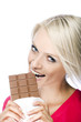 Woman eating a tempting bar of chocolate