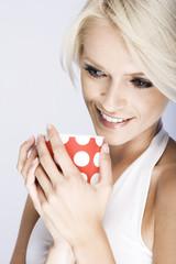 Beautiful woman enjoying a mug of coffee