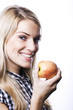 Healthy blond woman with an apple