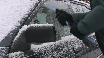 Scraping ice off car. Toronto, Ontario.