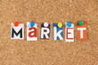 The word Market in cut out magazine letters