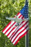 A security drone on star and stripes USA flag poster