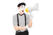 A male mime artist holding a loudspeaker and looking at camera