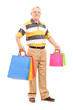 Full length portrait of a mature gentleman with shopping bags