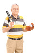 Smiling middle aged man holding a wooden baseball bat and glove