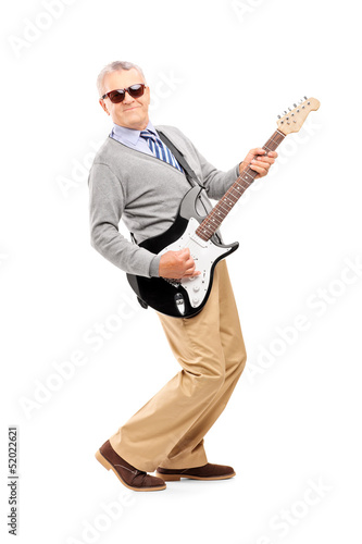 Full length portrait of a smiling mature man playing guitar