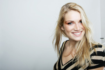 Smiling blond woman in a stylish top