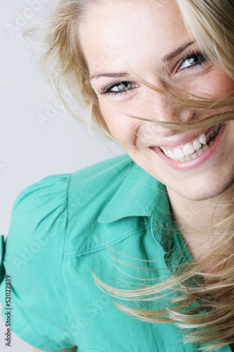 Vivacious laughing blond woman