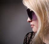 Profile of a woman in fashion sunglasses