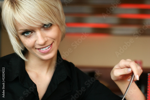 Young blond woman with a gentle smile