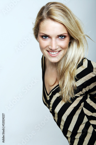 Smiling blond woman in a striped top