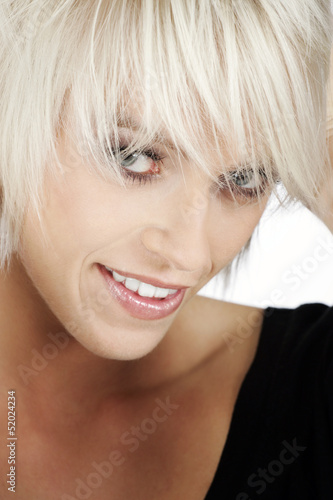 Smiling young blond with a trendy modern hairstyle