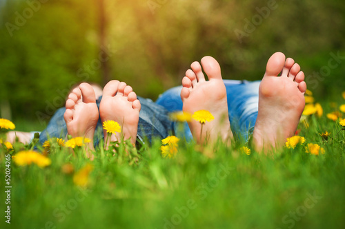 Keuken foto achterwand Picknick feet on grass. Family picnic in spring park