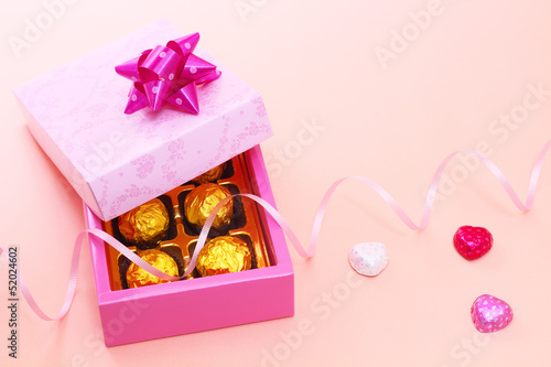Chocolates in cute gift box with colorful hearts