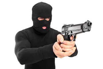 A thief with robbery mask holding a gun
