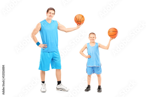 Full length portrait of a basketball players posing