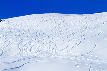Ski Tracks on Snowcovered Mountain Side