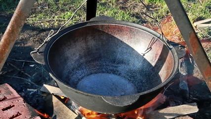 Cooking pilaf. Pour oil