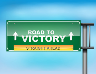 "Highway sign with ""Road to Victory"" text"