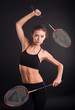 Beautiful girl with a rackets in hands