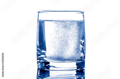 Two tablet in glass of water