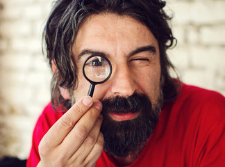Attractive Man with Magnifying Glass