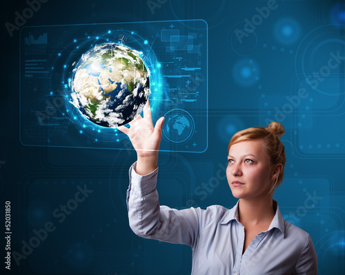 Young buinesswoman touching high-tech 3d earth panel