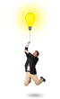 Happy man holding a light bulb balloon