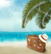 Vintage beautiful seaside background with suitcase and a hat. Ve