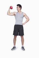 Athlete lifting dumbbell