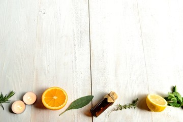 Fruits,herbs and aromatherapy.on white wood background