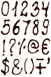 Numbers and symbols set written with chocolate syrup