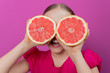 Grapefruit - a young girl with grapefruits - diet concept
