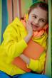 Young girl in headphones resting in hammock