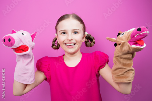 Happy child - girl playing theater