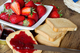 strawberries jam with rusk on wooden table