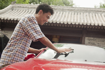 Young Man Cleaning His Car