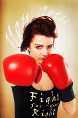 pretty lady with red boxing gloves