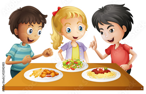 Kids watching the table with foods