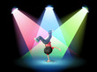 A boy breakdancing at the stage with spotlights