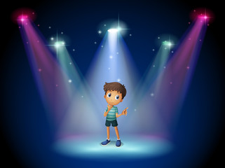 A boy acting at the stage with spotlights