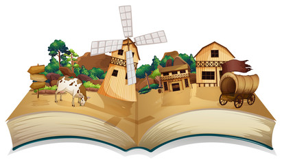 A book with an image of a village and wooden arrowboards
