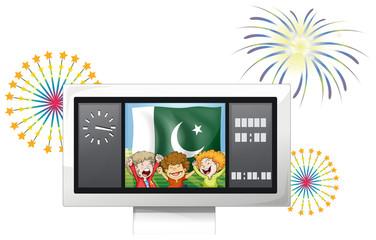Three kids inside the scoreboard in front of the Pakistan flag