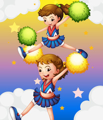 Two cheerdancers with their pompoms