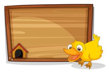 A duck beside an empty wooden board