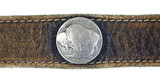 Close view buffalo nickel on belt