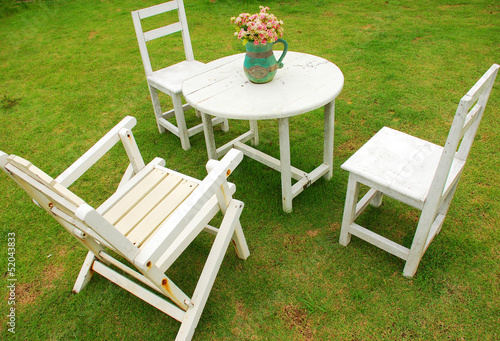 White chairs with round table