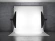 Dark photo studio with lighting equipment