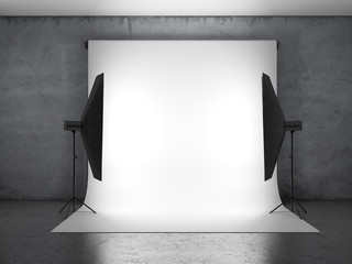 Dark photo studio with lighting equipment
